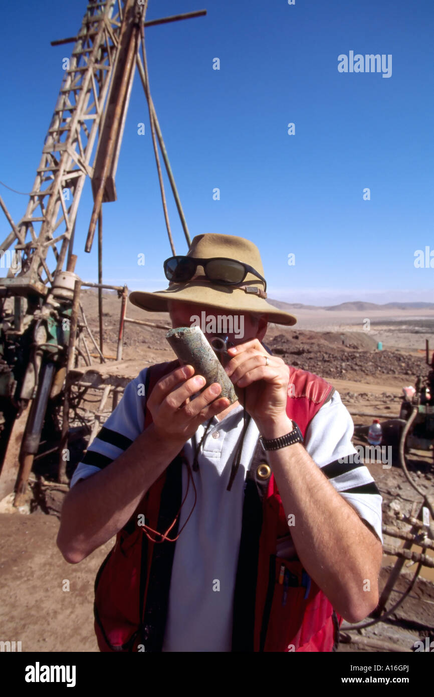 geologist checking core sample in mining camp Atacama Desert Chile - Stock Image