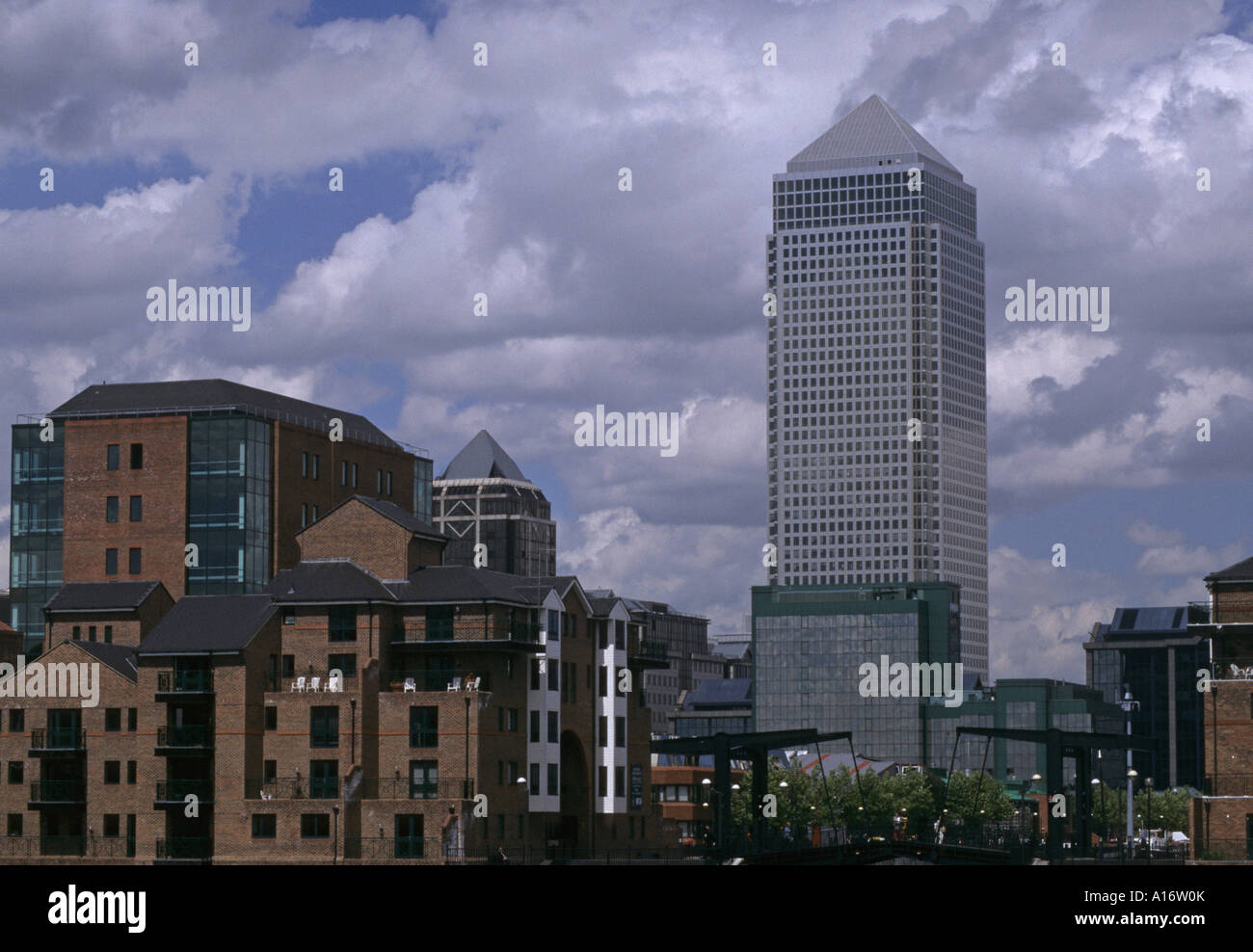 towers of Canary Wharf and modern apartments Millwall Docks London Docklands England - Stock Image