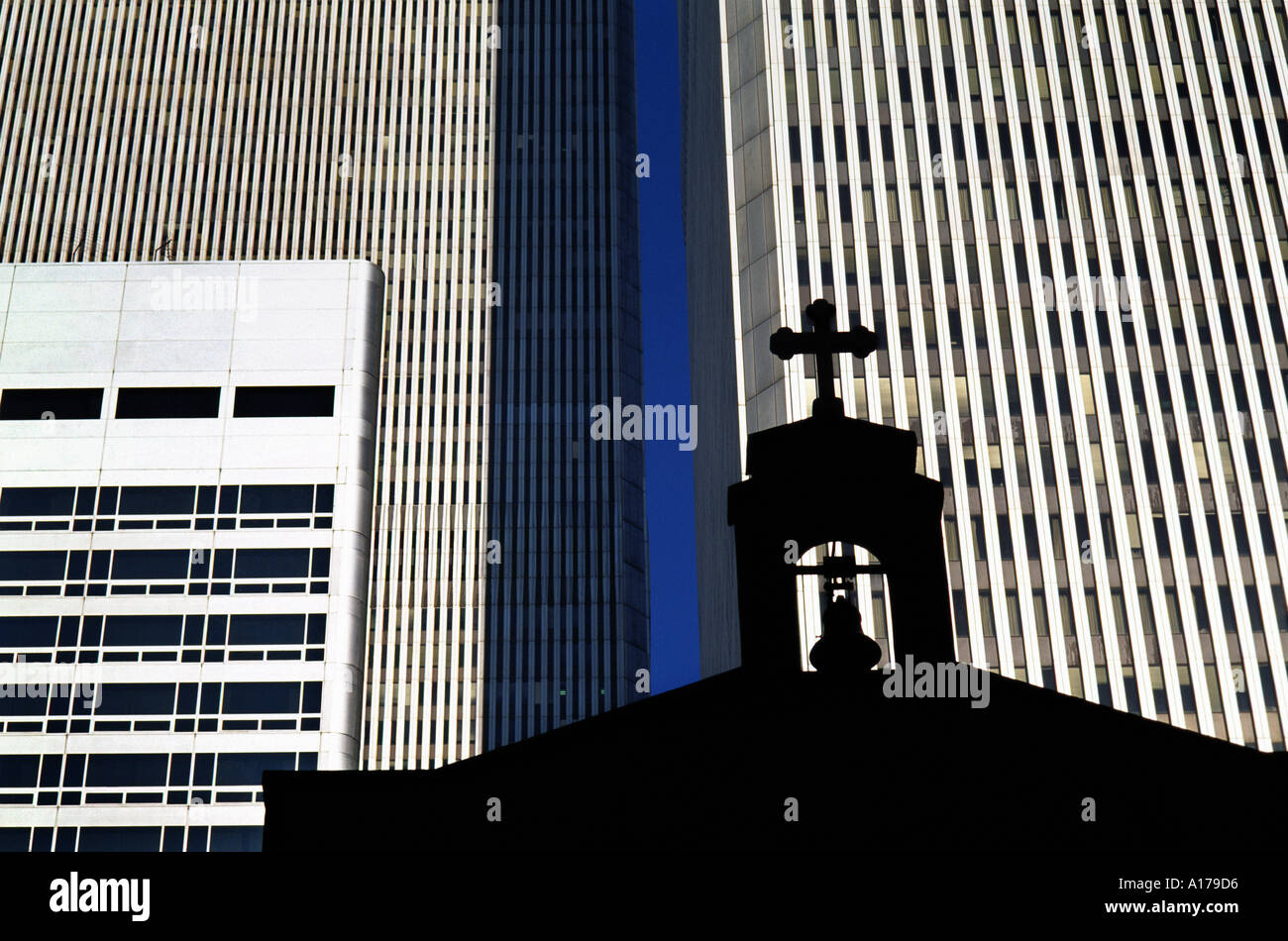 silhouette of old church in front of world trade towers New York - Stock Image