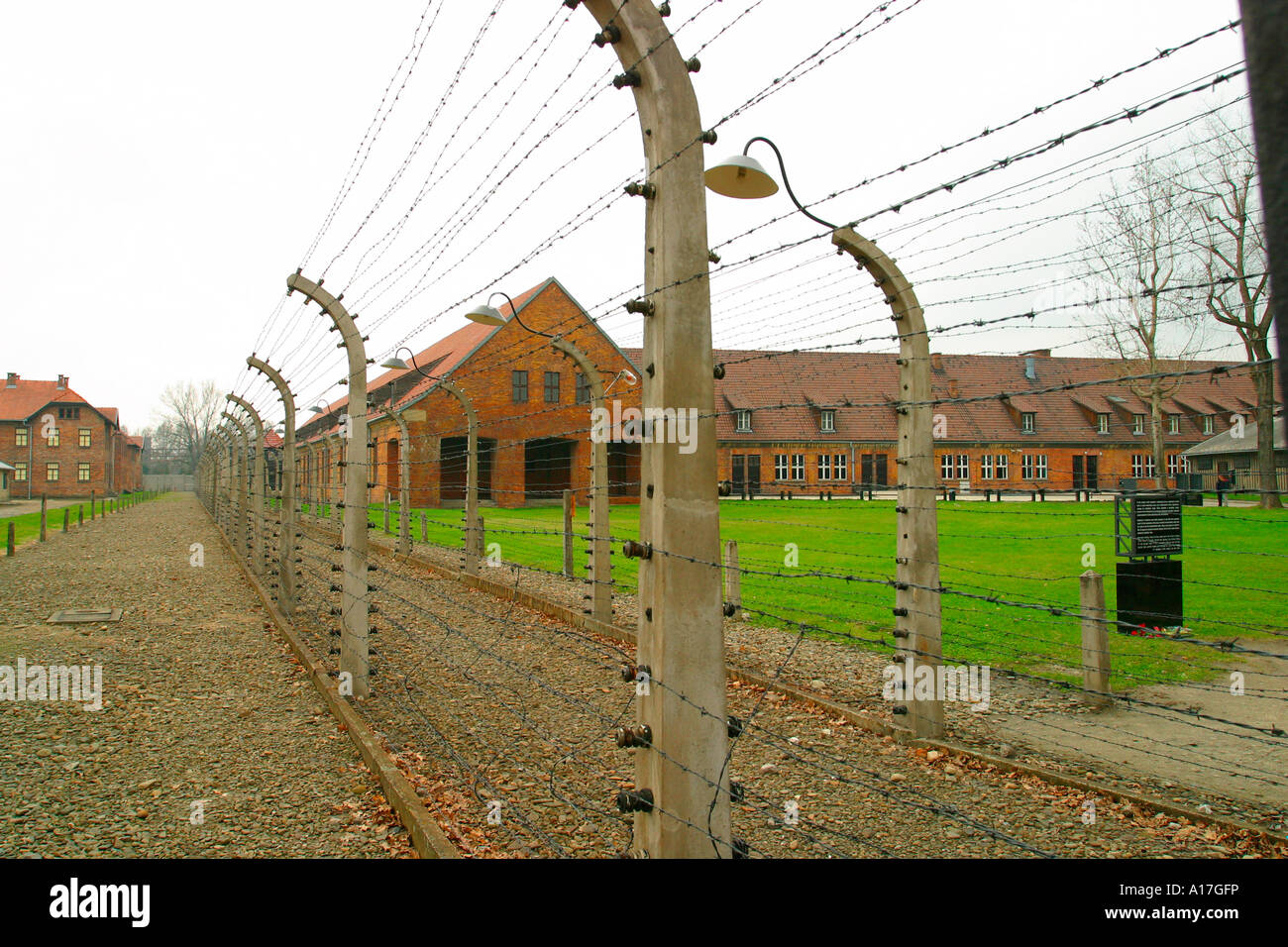 The barbed wire fence at Auschwitz concentration camp, Oswiecim, Poland. - Stock Image