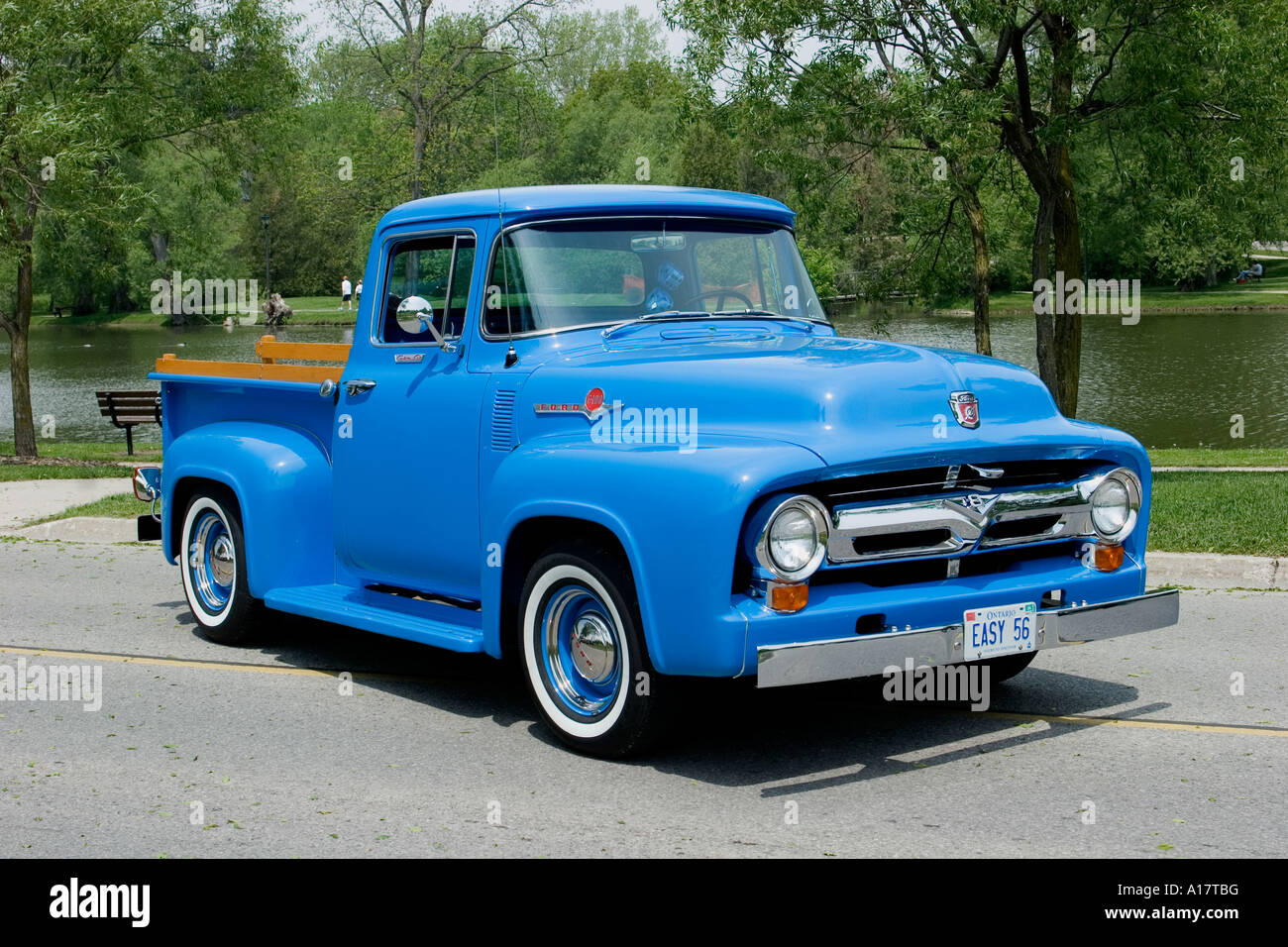 1956 ford f100 custom cab pickup truck on pavement