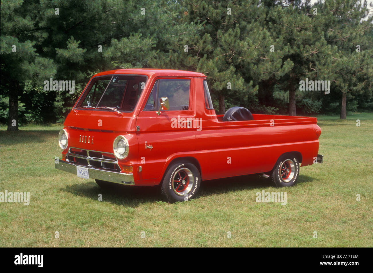 1966 dodge a 100 compact pick up truck on grass stock photo 1966 dodge a 100 compact pick up truck on grass publicscrutiny Choice Image