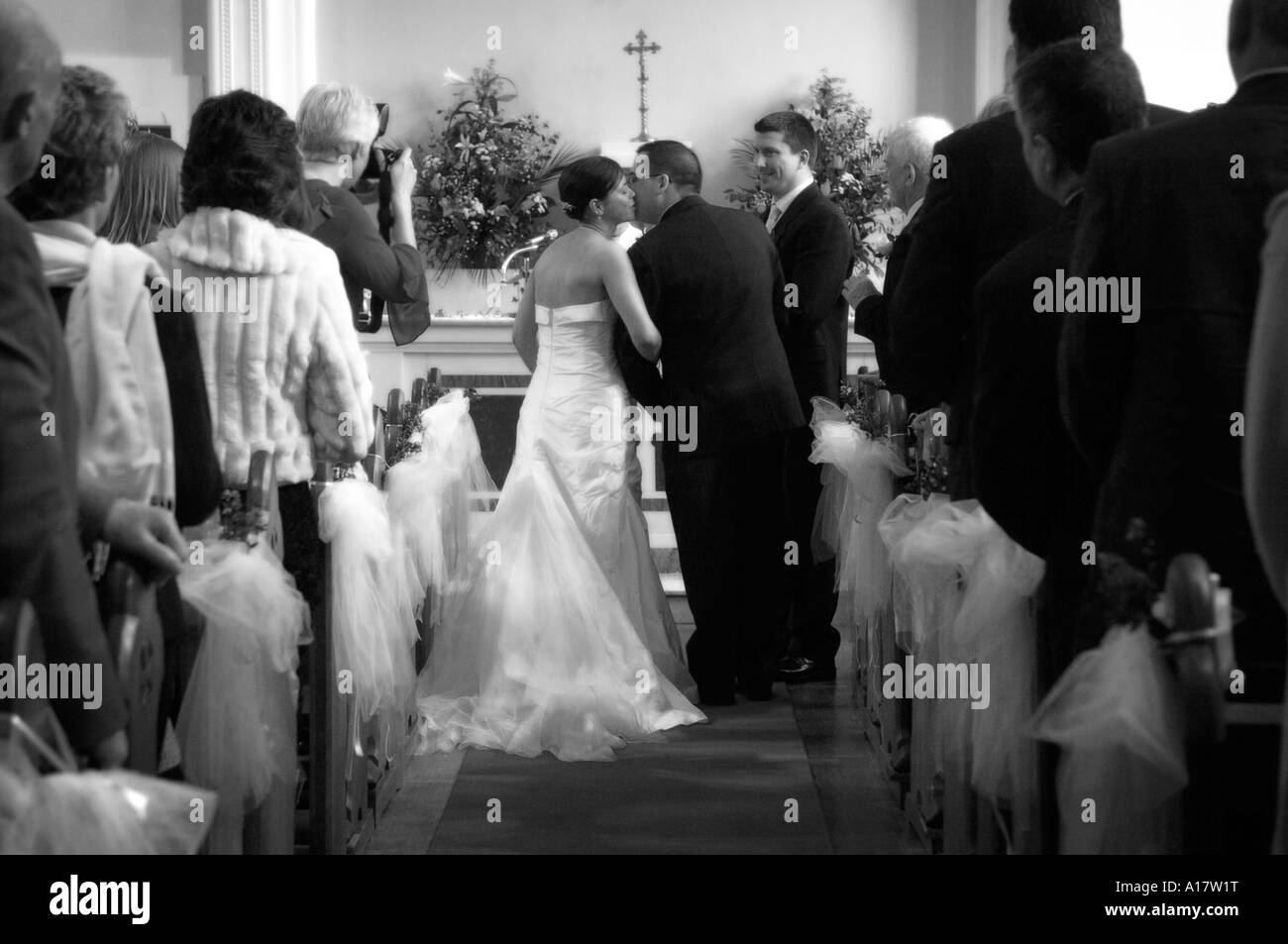 A bride being given away at the altar in a church - Stock Image