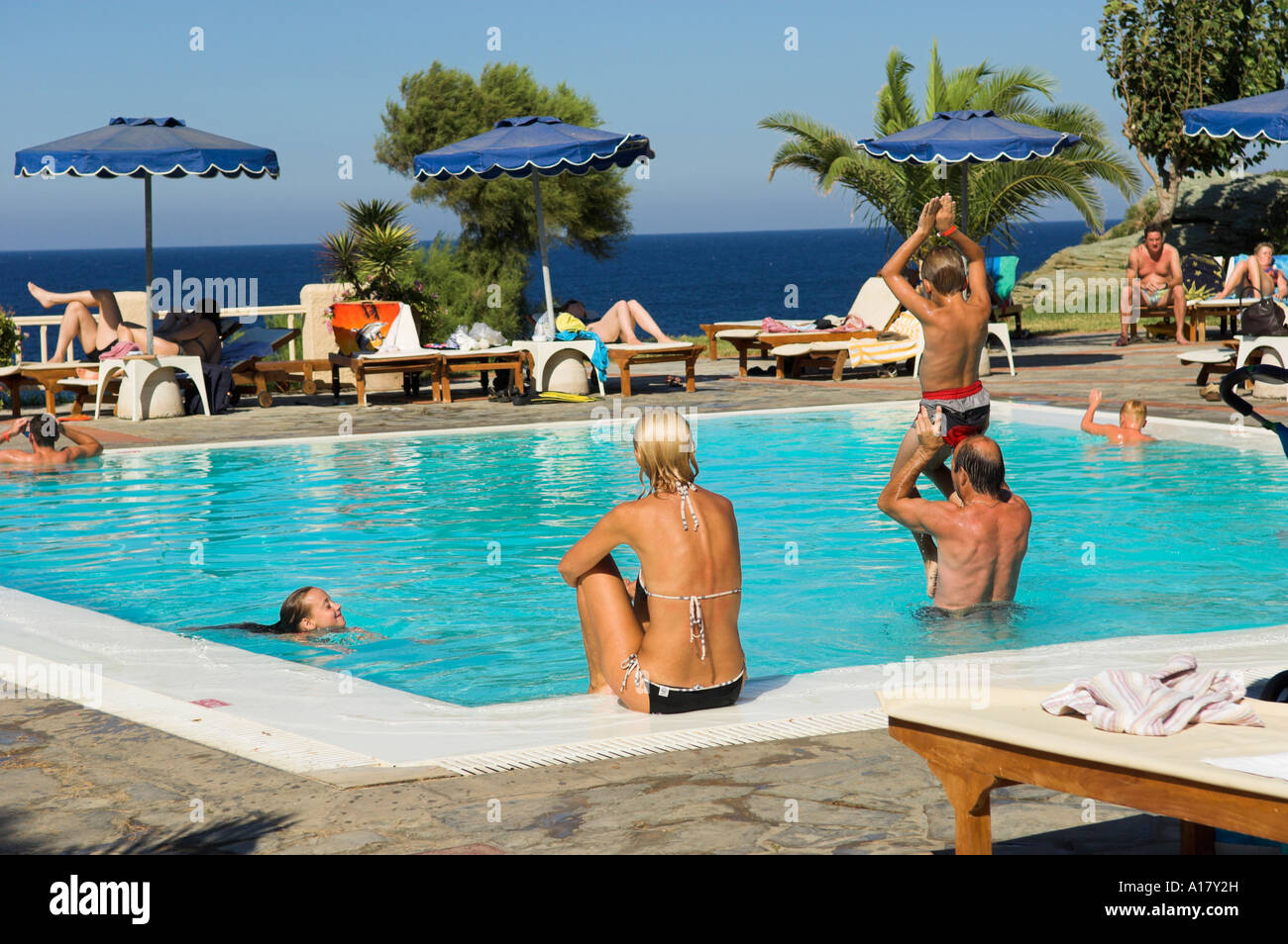 Hotel pool with people  People at hotel pool overlooking sea Stock Photo: 10172872 - Alamy