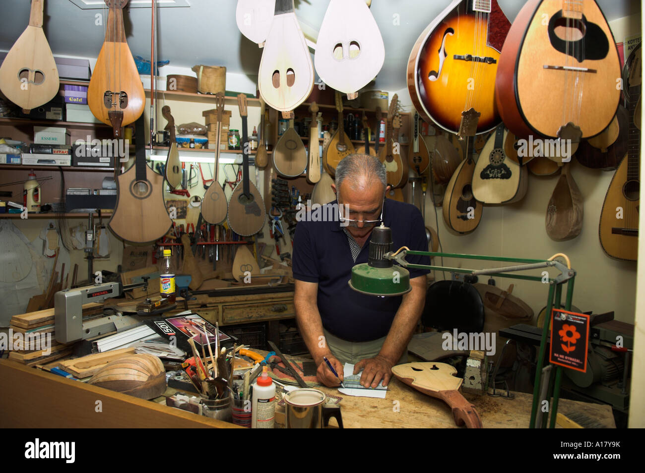 String instrument craftsman maker E Katsantonis in workshop Rethymnon Island of Crete Greece - Stock Image