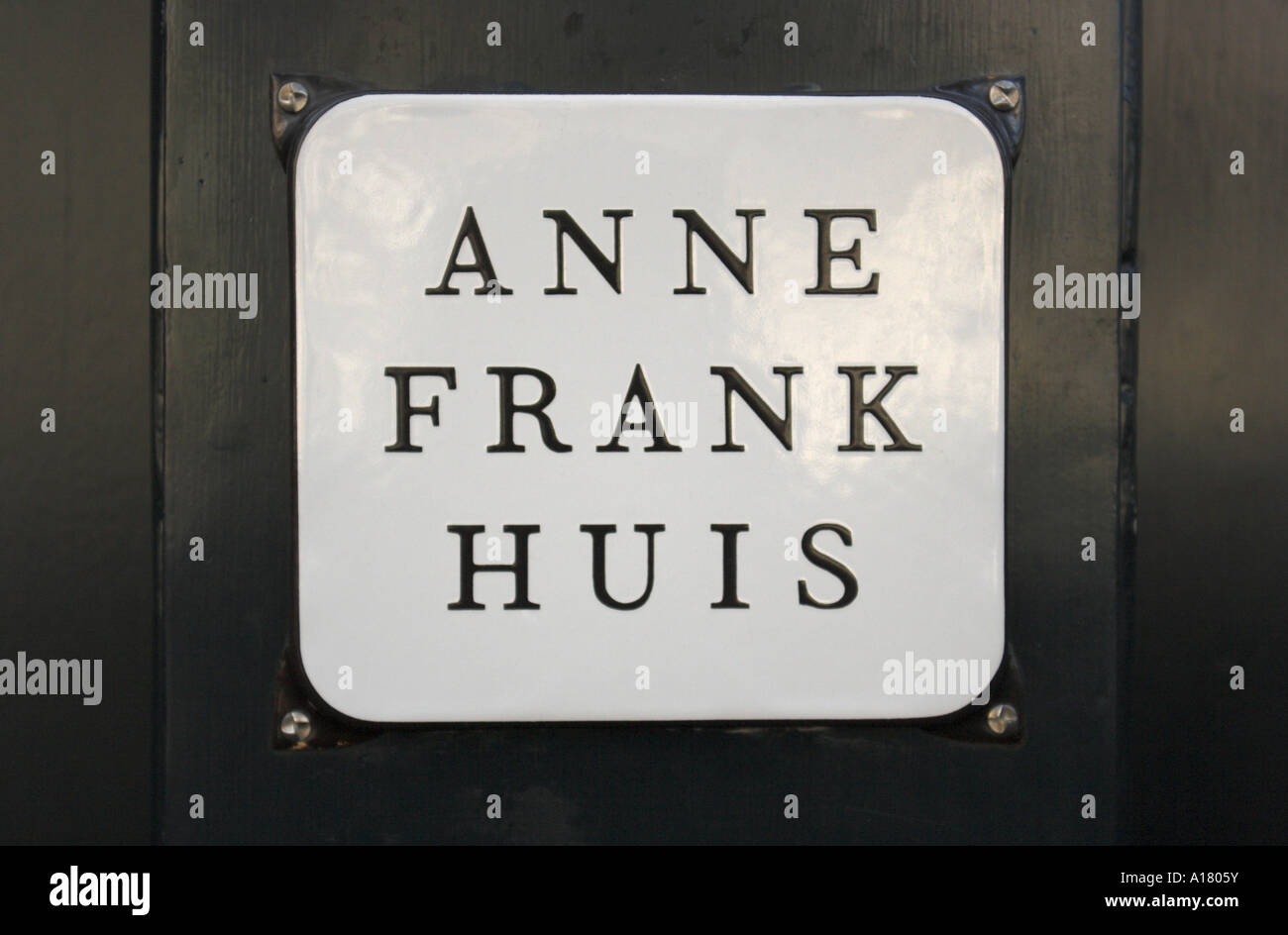 horizontal landscape photo of the plaque on the wall outside the house of Anne Frank in Amsterdam in the netherlands - Stock Image