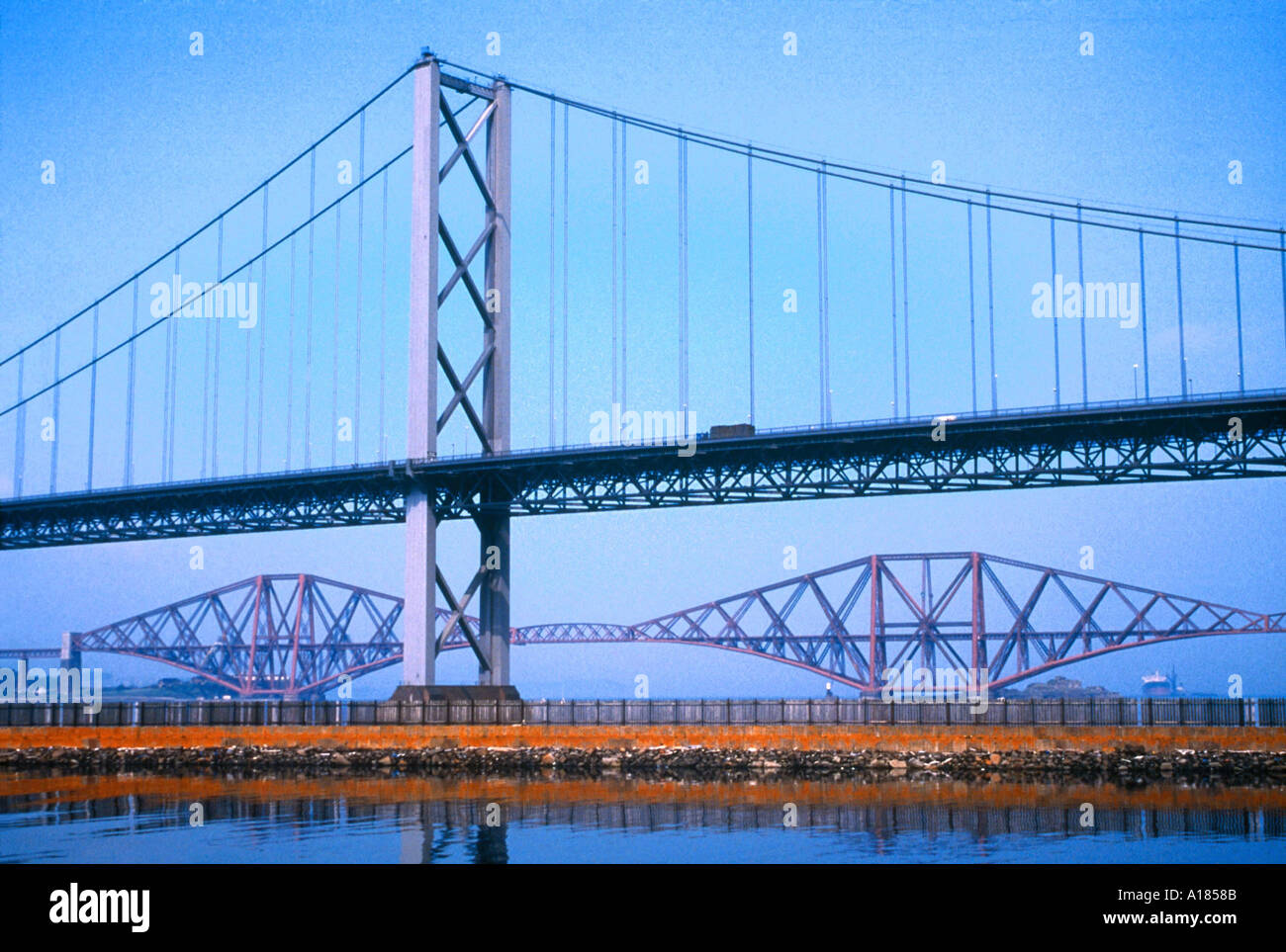 Road suspension bridge built in 1964 and the Forth Railway Bridge built in 1890 Firth of Forth Scotland UK A C Waltham - Stock Image