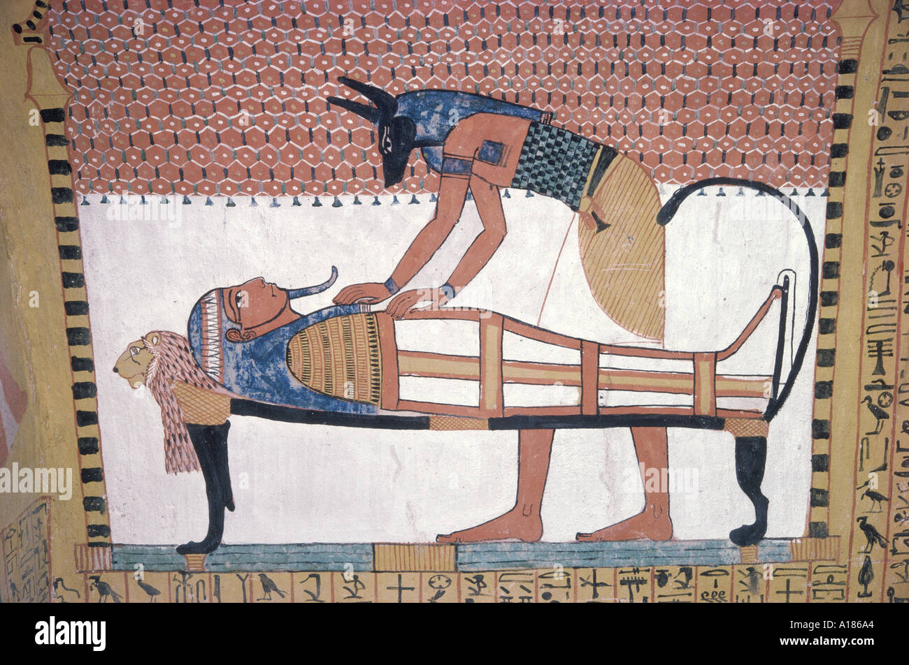 Mural showing the god Anubis leaning over mummy of Ramses II in the Tomb of Sinjin the chief artist to Ramses II Deir el Medina - Stock Image