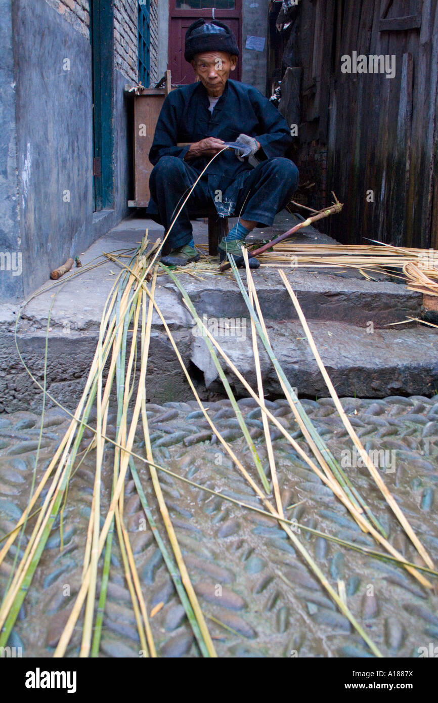 Elderly Chinese Man Prepares Bamboo for Weaving, Zhaoxing, China Stock Photo