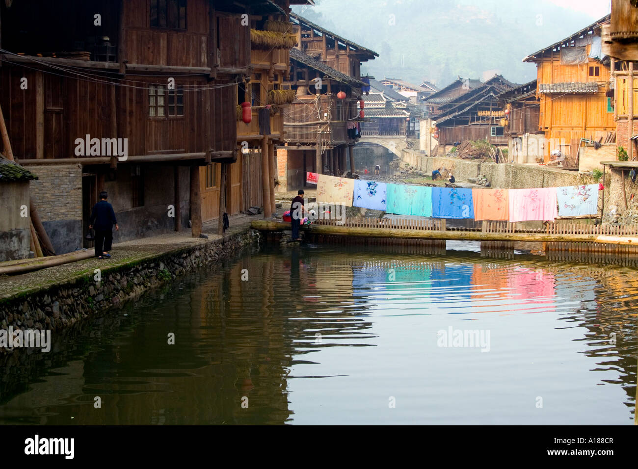 Bedding Hung out to Dry over the River Rural in the Dong Chinese Ethnic Minority Town of Zhaoxing China Stock Photo