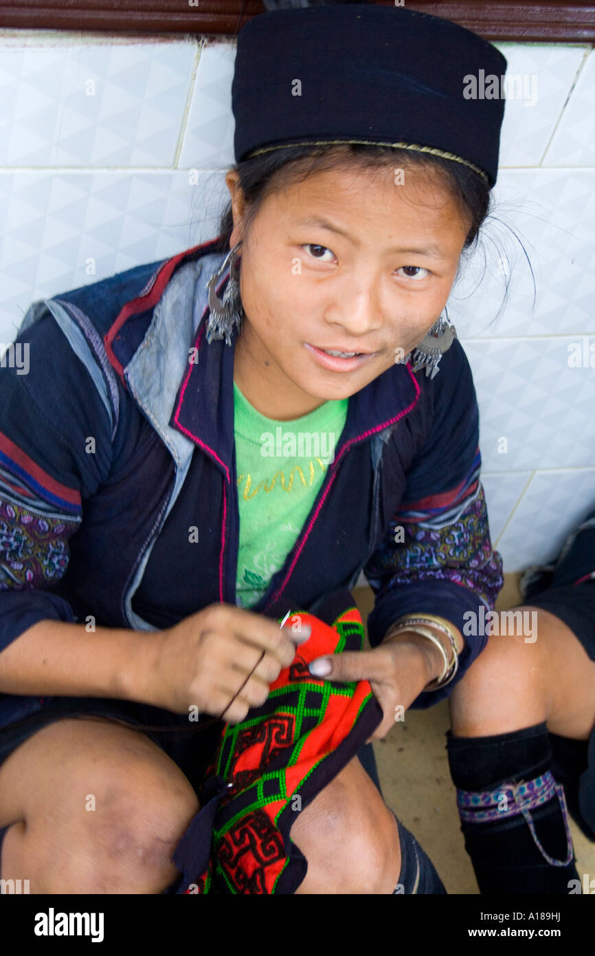 Hmong Girl in Traditional Clothes Hand Sewing Sapa Vietnam Stock Photo