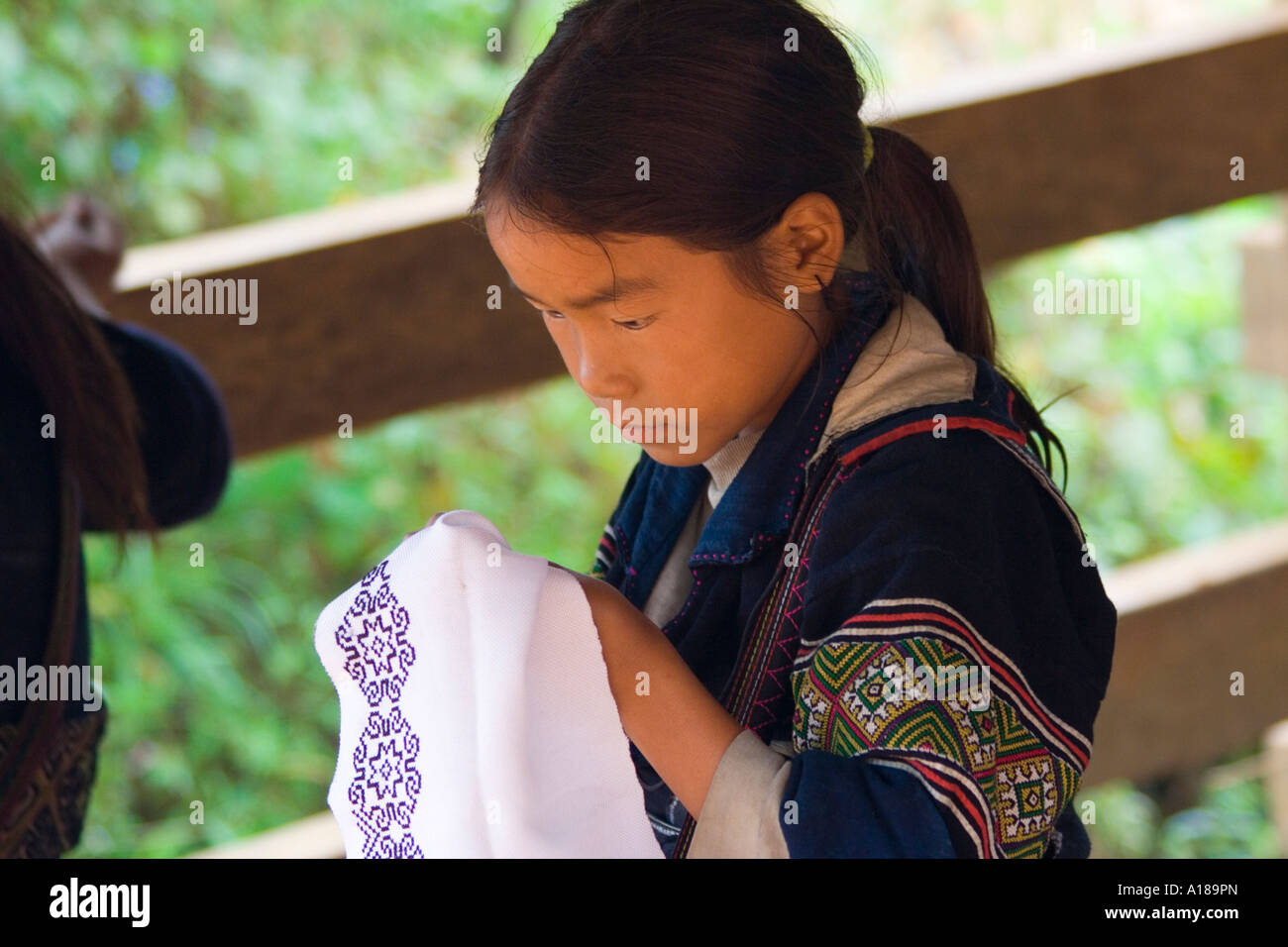2007 Pretty Young Hmong Girl in Traditional Clothing Sewing Sapa Vietnam Stock Photo