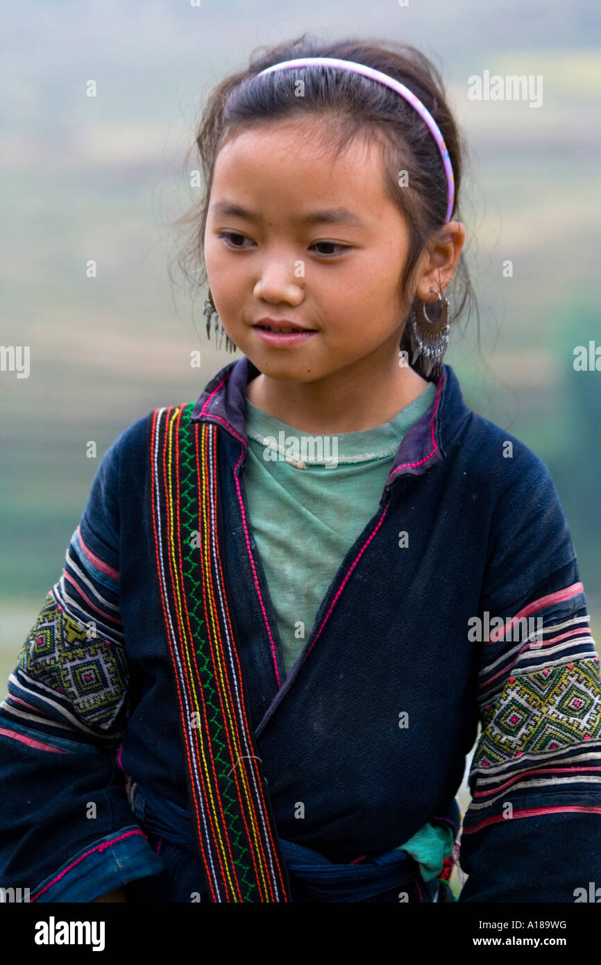 Beautiful Young Girl Wearing Traditional Clothing in the Hills near Sapa Vietnam Stock Photo