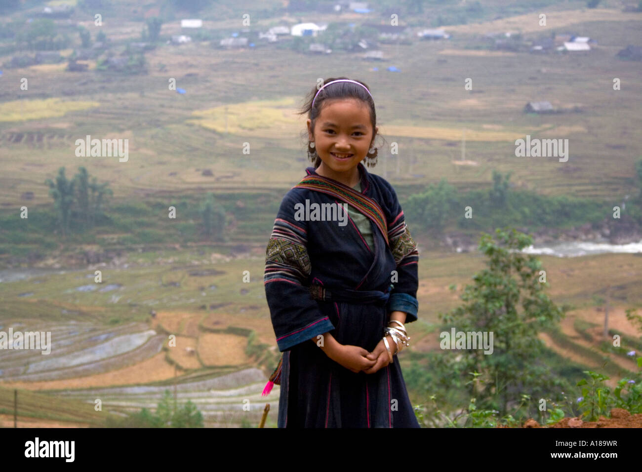 2007 Beautiful Young Hmong Girl in Traditional Clothing in front of Rice Field Terraces Sapa Vietnam Stock Photo