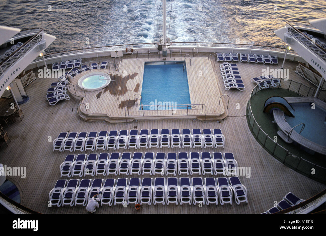sun loungers around a swimming pool on a cruise ship Stock Photo