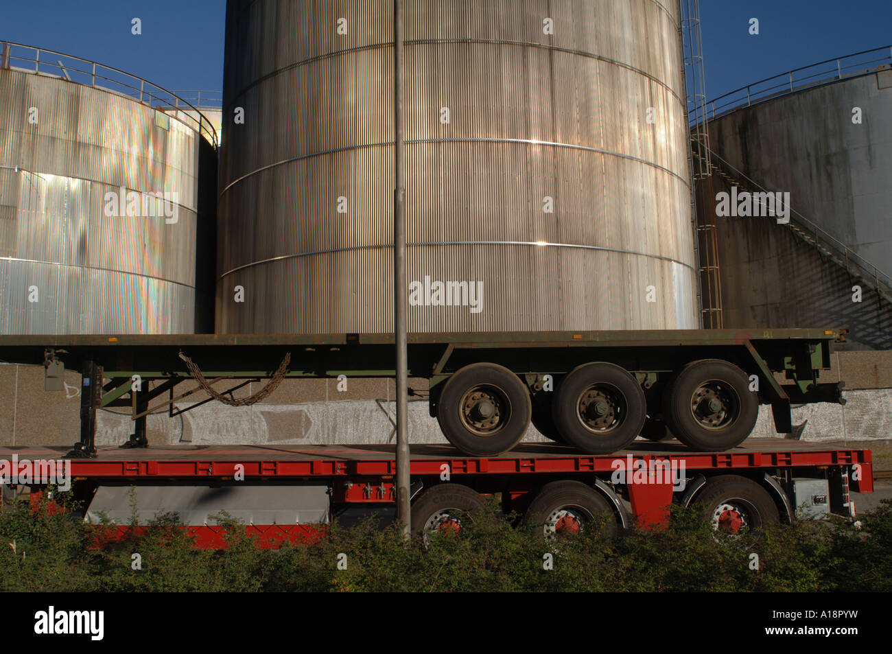 Semi abstract image of gas storage containers and lorry trailer