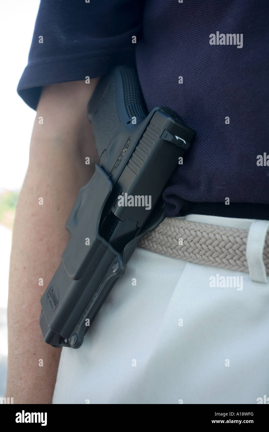 Glock model 22   40 caliber in paddle type holster  Female