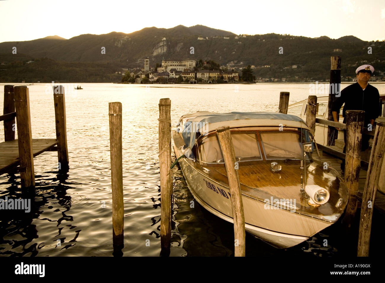 Orta San Giulio - motorboat and sailor for a trip to the small famous island - Stock Image