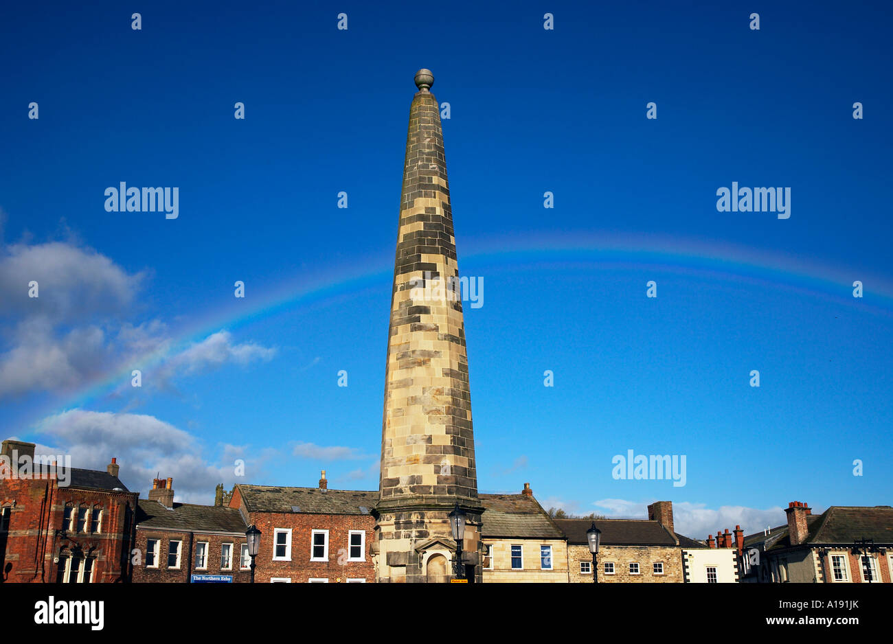 Rainbow over the obelisk in the Market Place Richmond North Yorkshire England Stock Photo