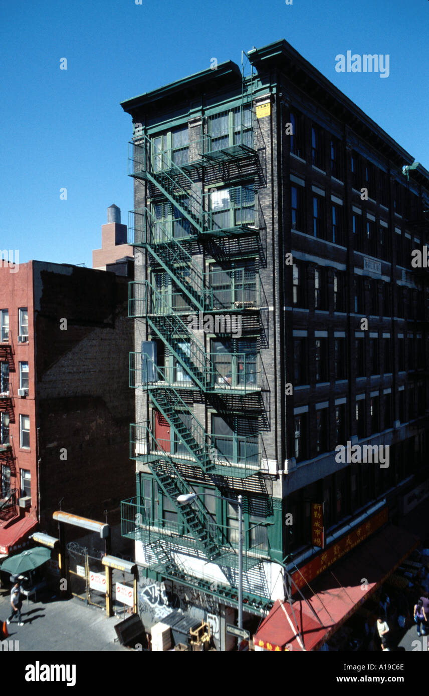 Tenement building housing several sweat shops in Chinatown New York NY USA - Stock Image