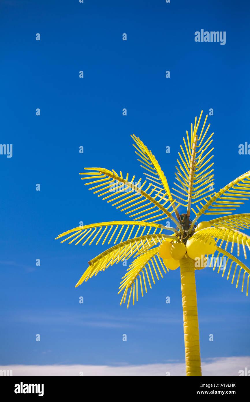 Plastic palm tree near boardwalk oceanfront resort area Virginia Beach VA Virginia - Stock Image