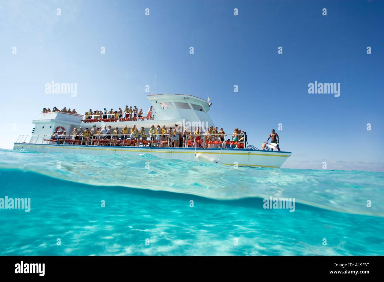 Under over session at Sandbar North Sound Grand Cayman Cayman Islands - Stock Image