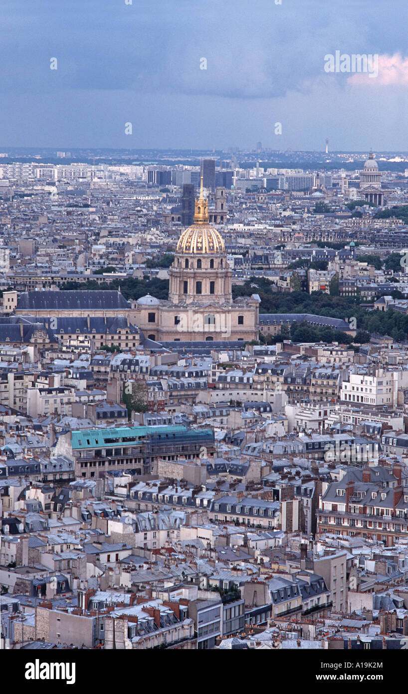 View from the Eiffel Tower across the rooftops of Paris towards the golden dome of the church of Saint Louis des - Stock Image