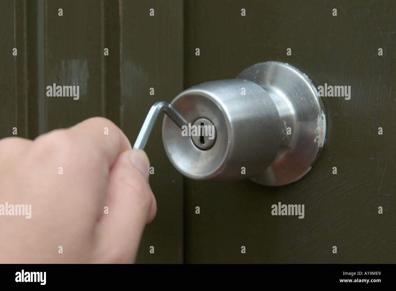 hand using allen key trying to open doorknob Concept Not