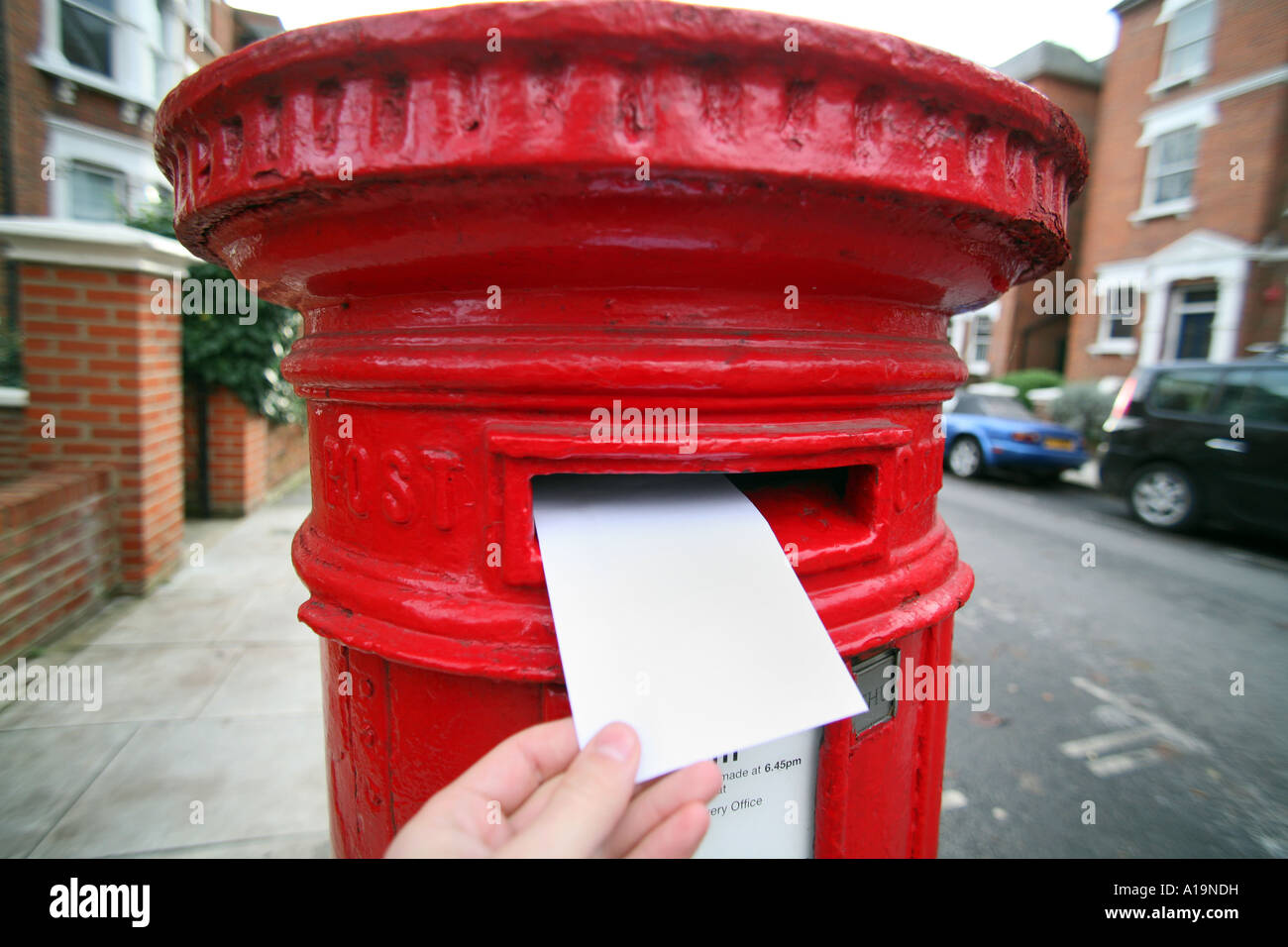 posting letter in UK Postbox - Stock Image