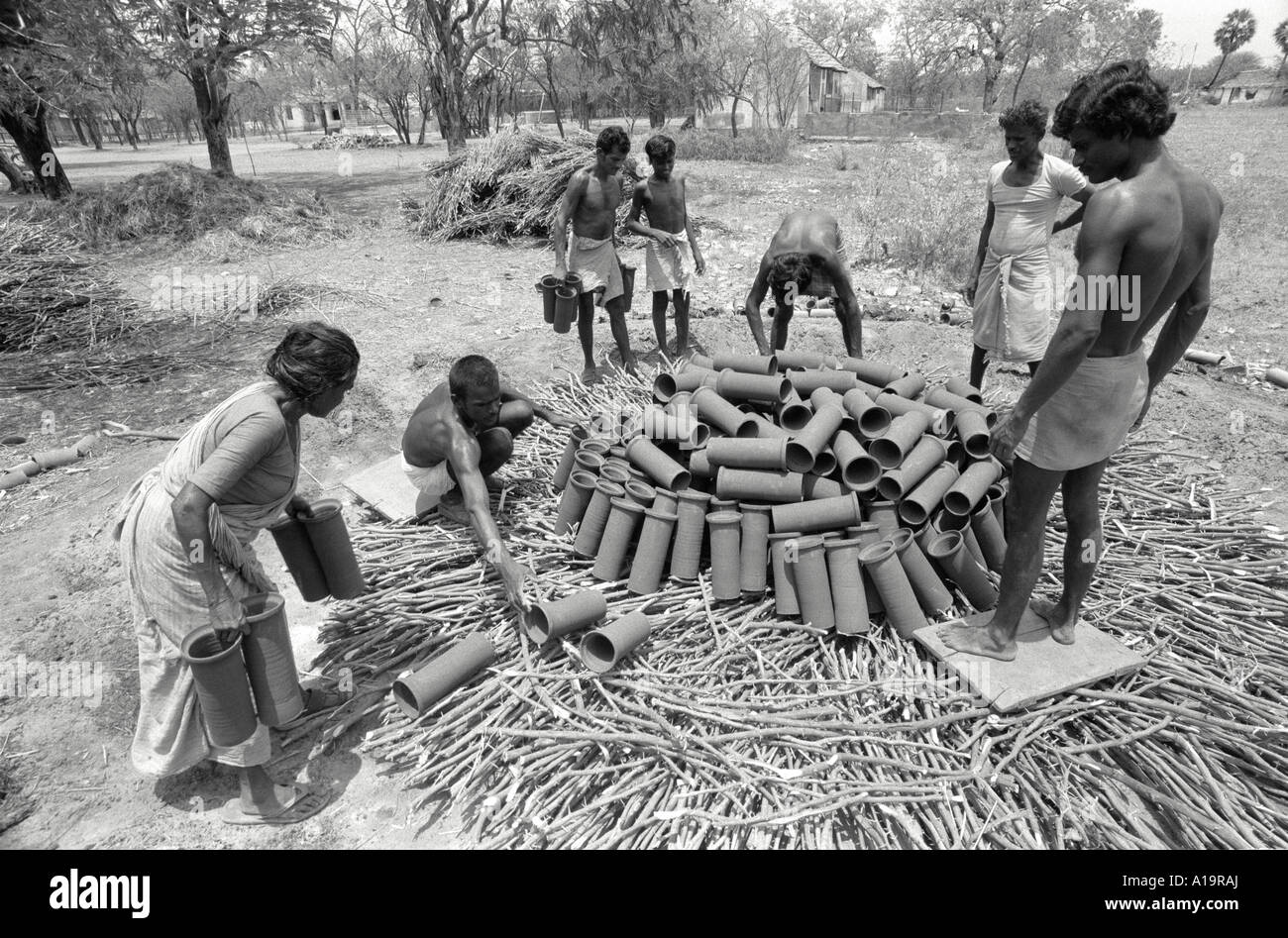 Pottery workers loading a kiln. India - Stock Image
