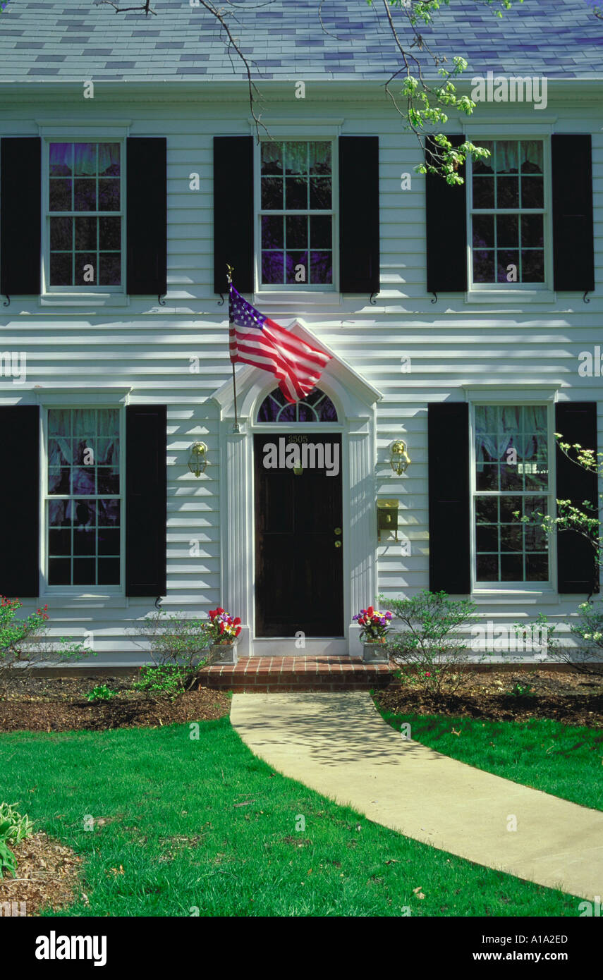 American flag hangs beside the front door of a traditional colonial home Raleigh North Carolina Property released & American flag hangs beside the front door of a traditional colonial ...