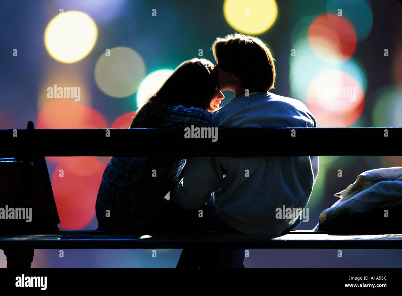 Two Young Lovers Sitting On A Park Bench Stock Photo 107916 Alamy