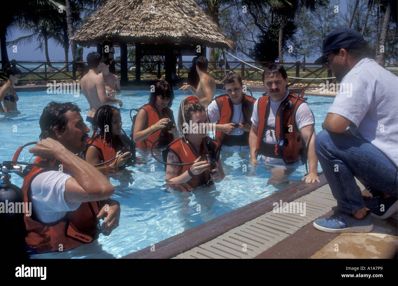 Guests learning to scuba dive in the hotel swimming pool Serena Beach Hotel Kenya coast East Africa - Stock Image