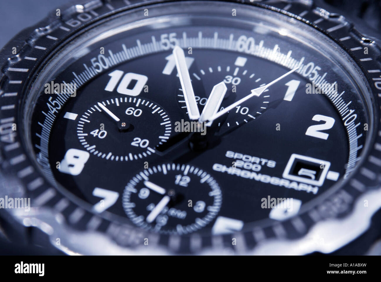 A Chronograph Shows Five Minutes Before Twelve Symbol For Date