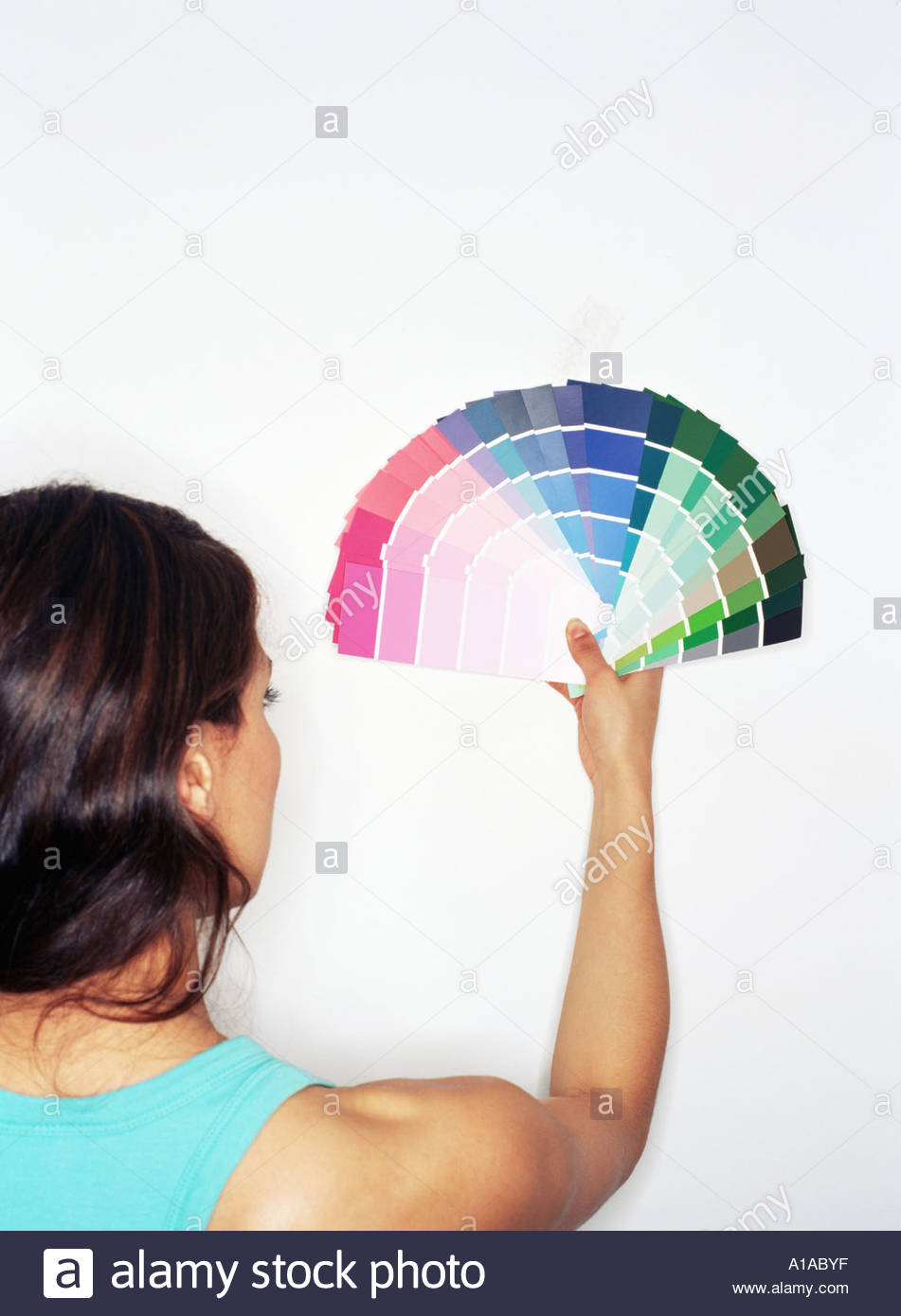 Woman holding colour swatches Stock Photo