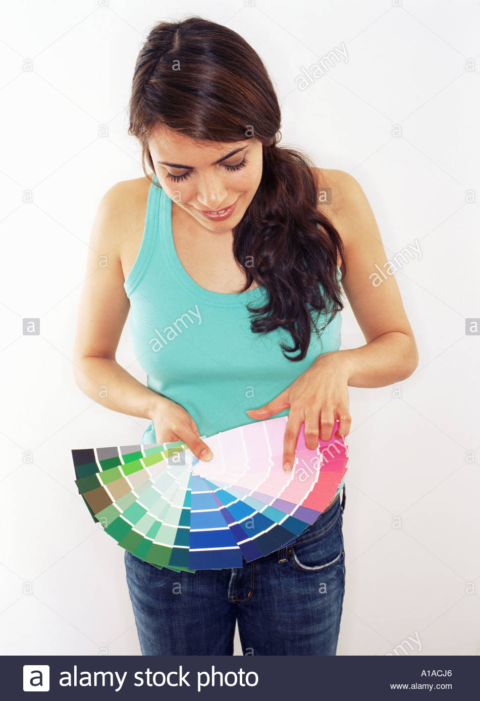 Woman holding colour swatches - Stock Image