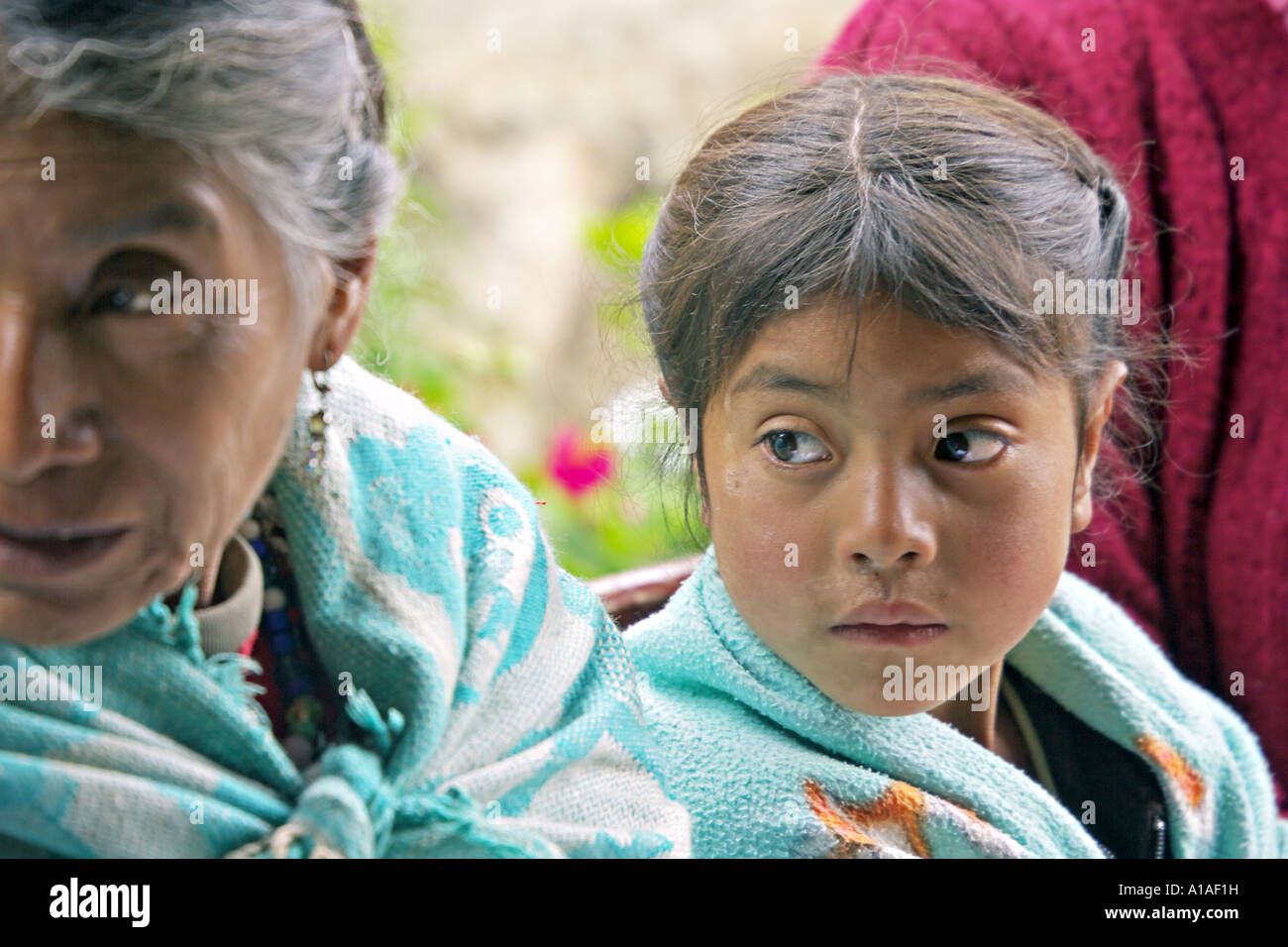 GUATEMALA CAPELLANIA Young indigenous Maya Ixil girl and her grandmother - Stock Image