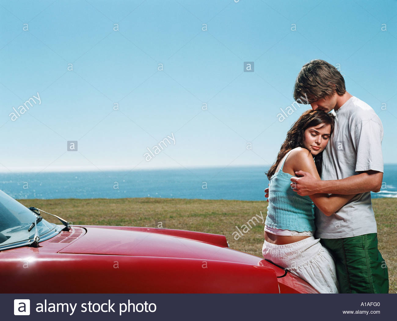 Intimate couple by vintage car - Stock Image