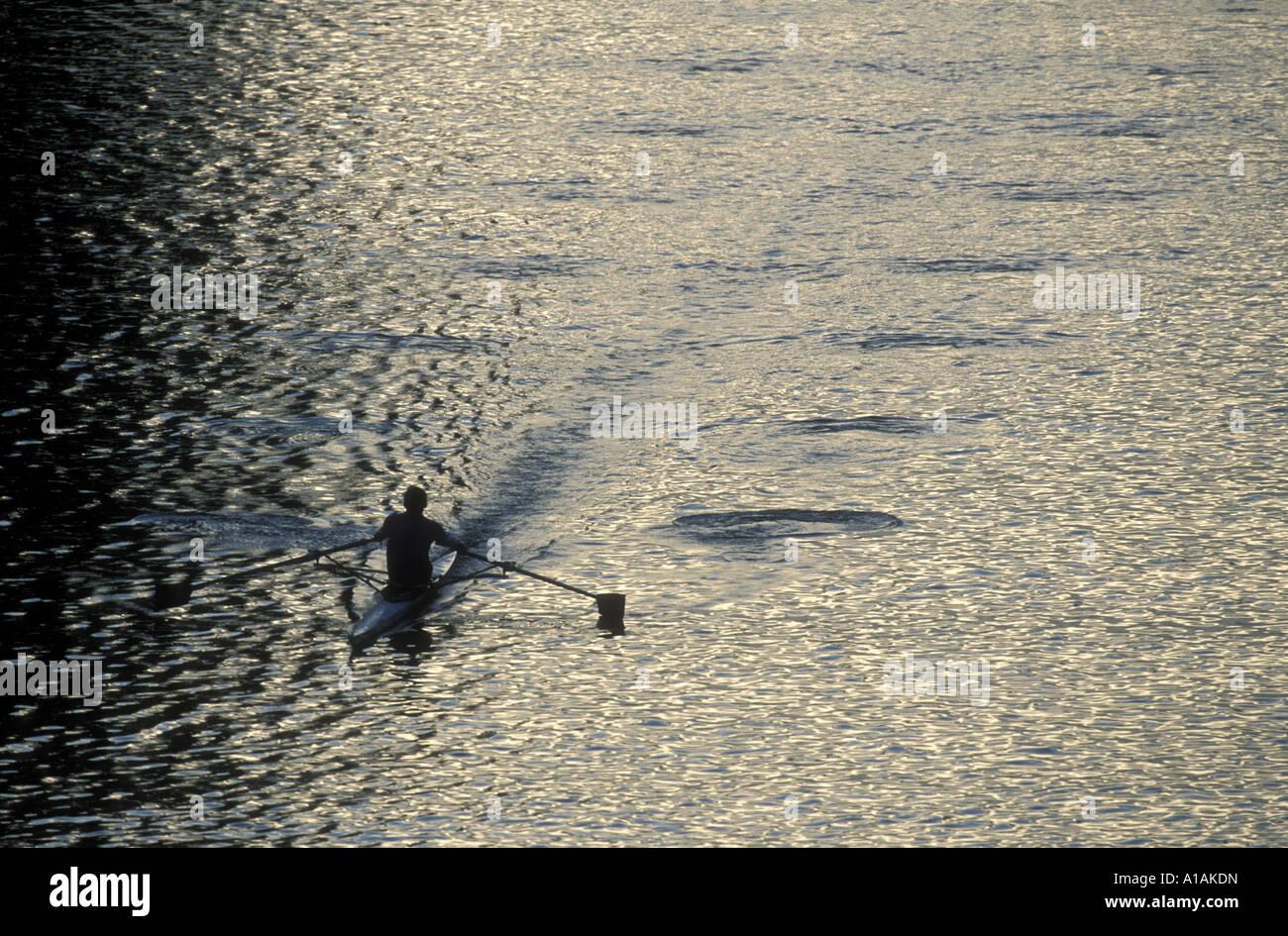 USA Washington Seattle Rower sculls through Montlake Cut at sunrise near entrance to Lake Washington - Stock Image