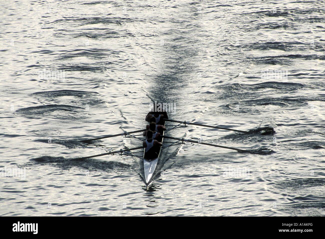 USA Washington Seattle Rowing teams scull through Montlake Cut during Husky Invitational at dawn in Lake Union - Stock Image