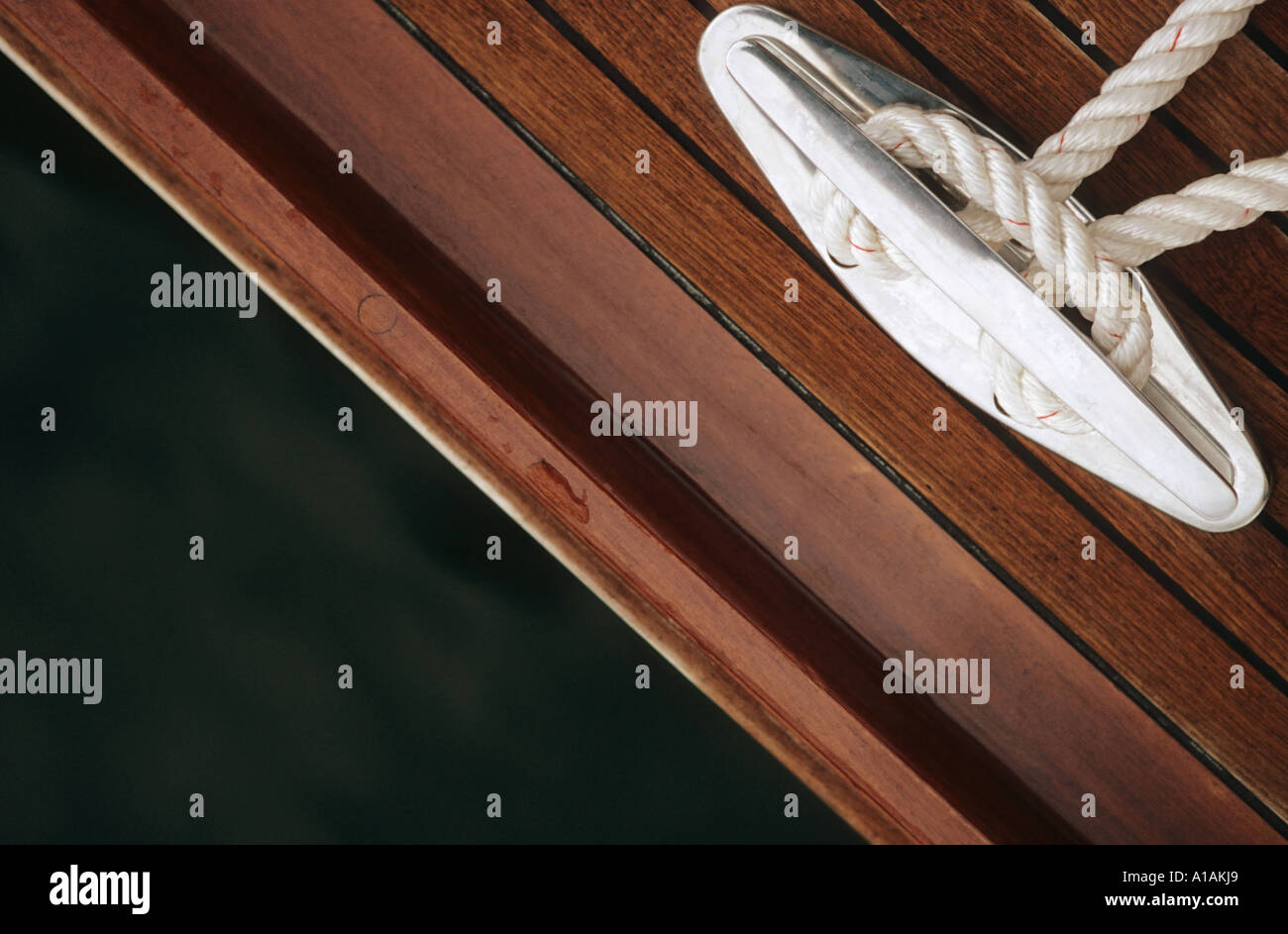 Close-up of rope tied to cleat - Stock Image