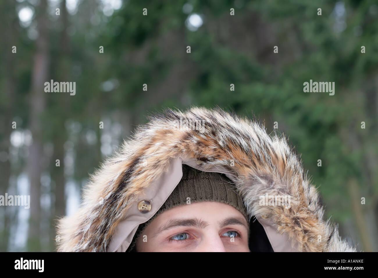 Man wearing a furry hood - Stock Image