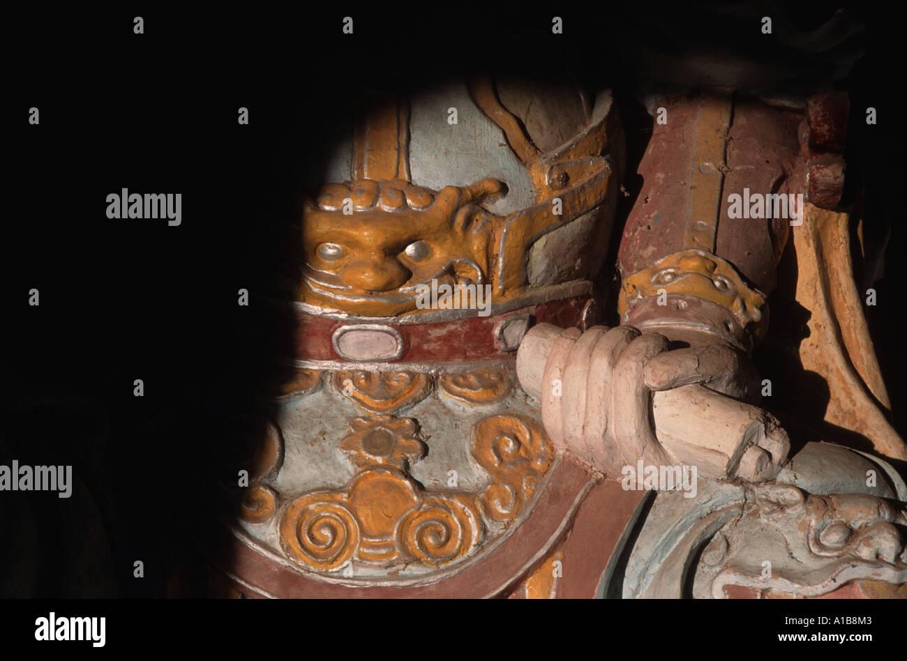 Hand holding a scroll Guardian figure Thien Mu Thien Mau Tu Linh Mu Pagoda Hue Vietnam - Stock Image