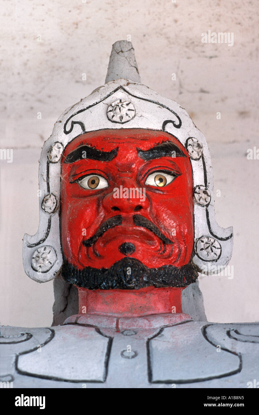 A fierce looking warrior statue in a temple on the Perfume Pagoda area Perfume River south of Hanoi Northern Vietnam - Stock Image