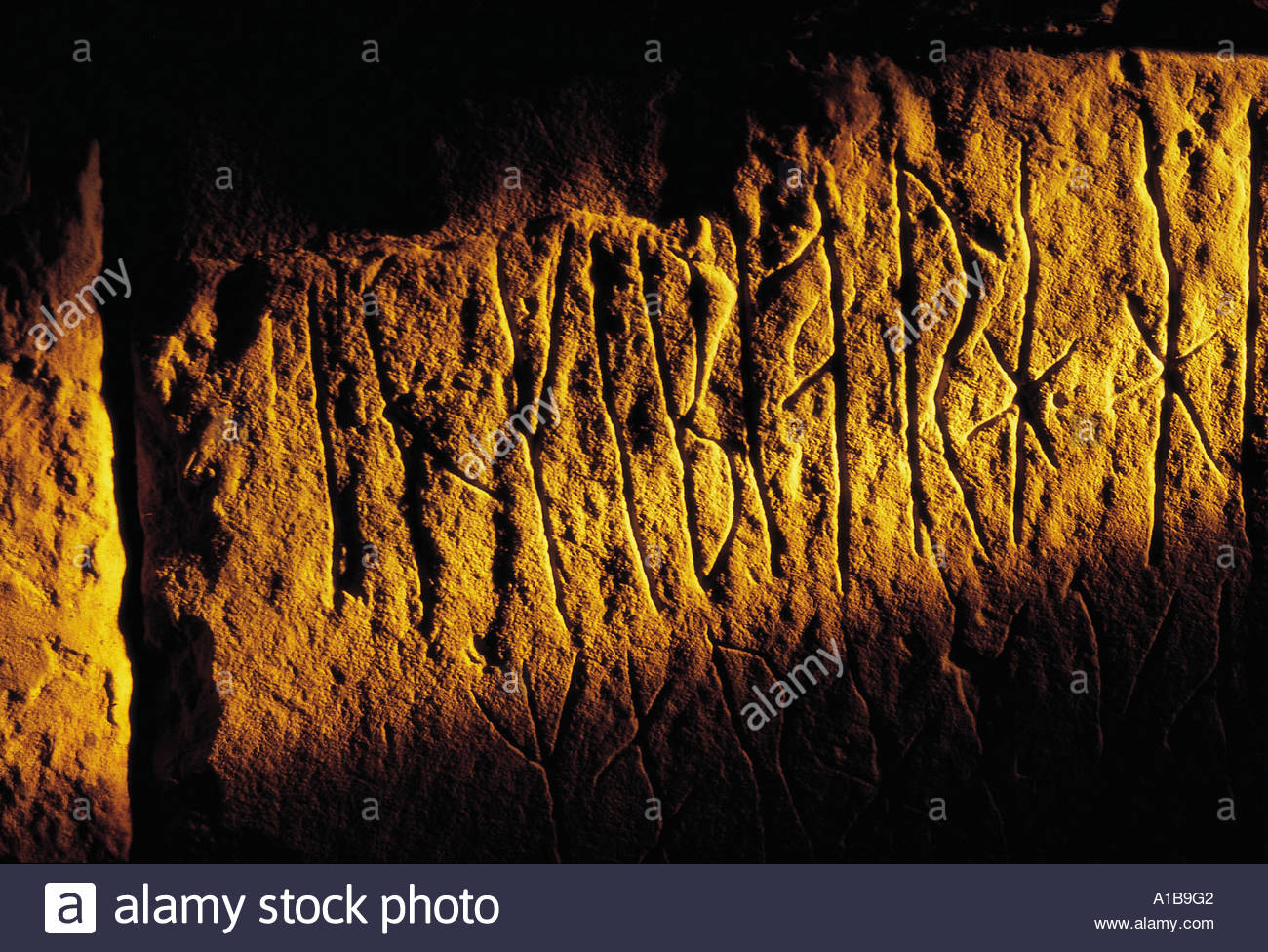 A DETAIL OF THE RUNIC INSCRIPTIONS AT MAES HOWE WEST OF FINSTOWN MAINLAND ORKNEY - Stock Image