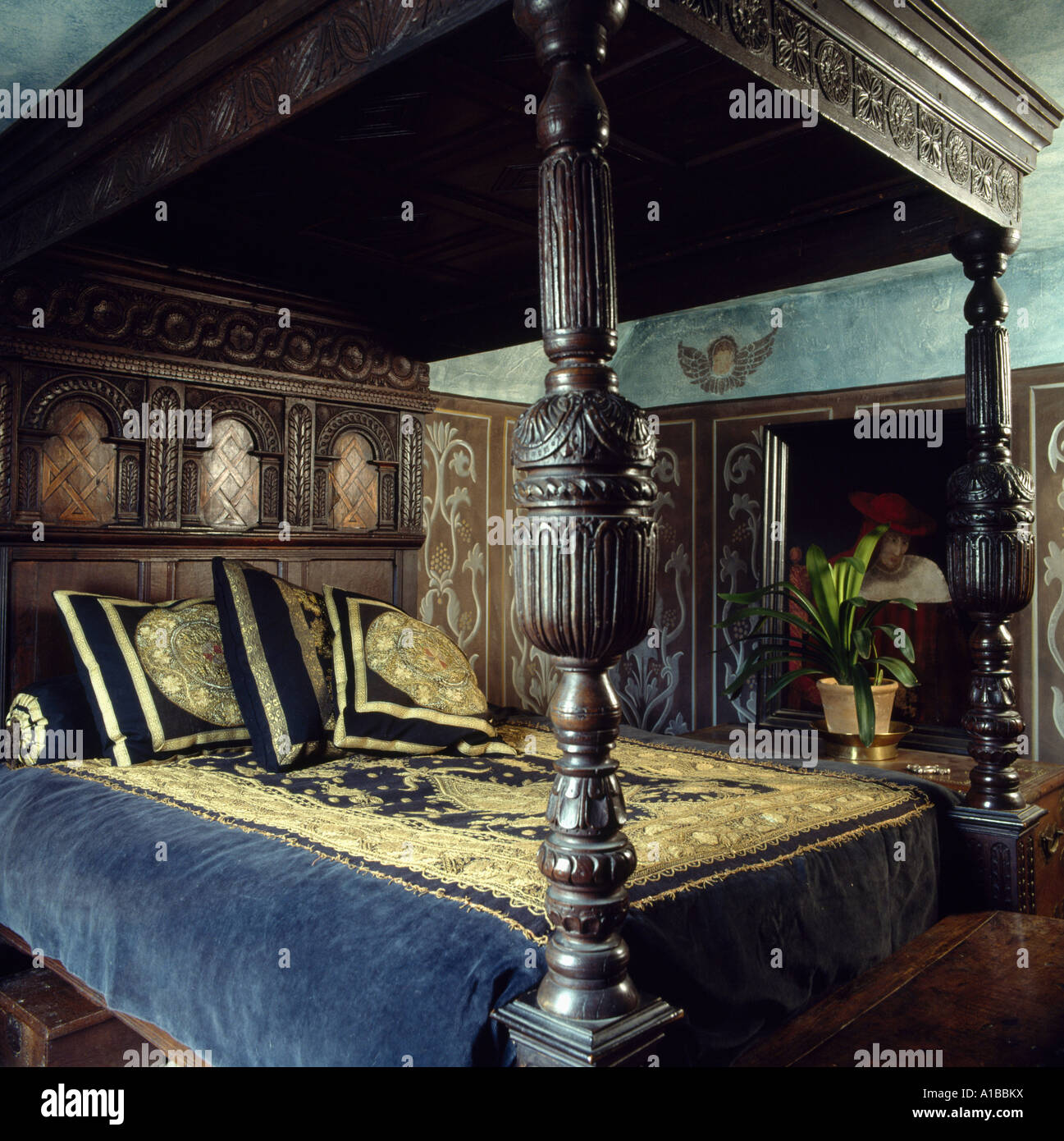 antique 4 poster bed Antique 4 poster bed with gold embroidered blue velvet bedspread  antique 4 poster bed