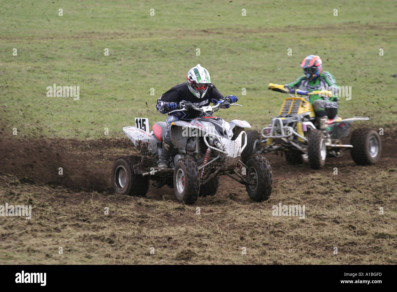 two quad Racers in action mud spraying from quad bike outside Ballymena County Antrim Northern Ireland - Stock Image