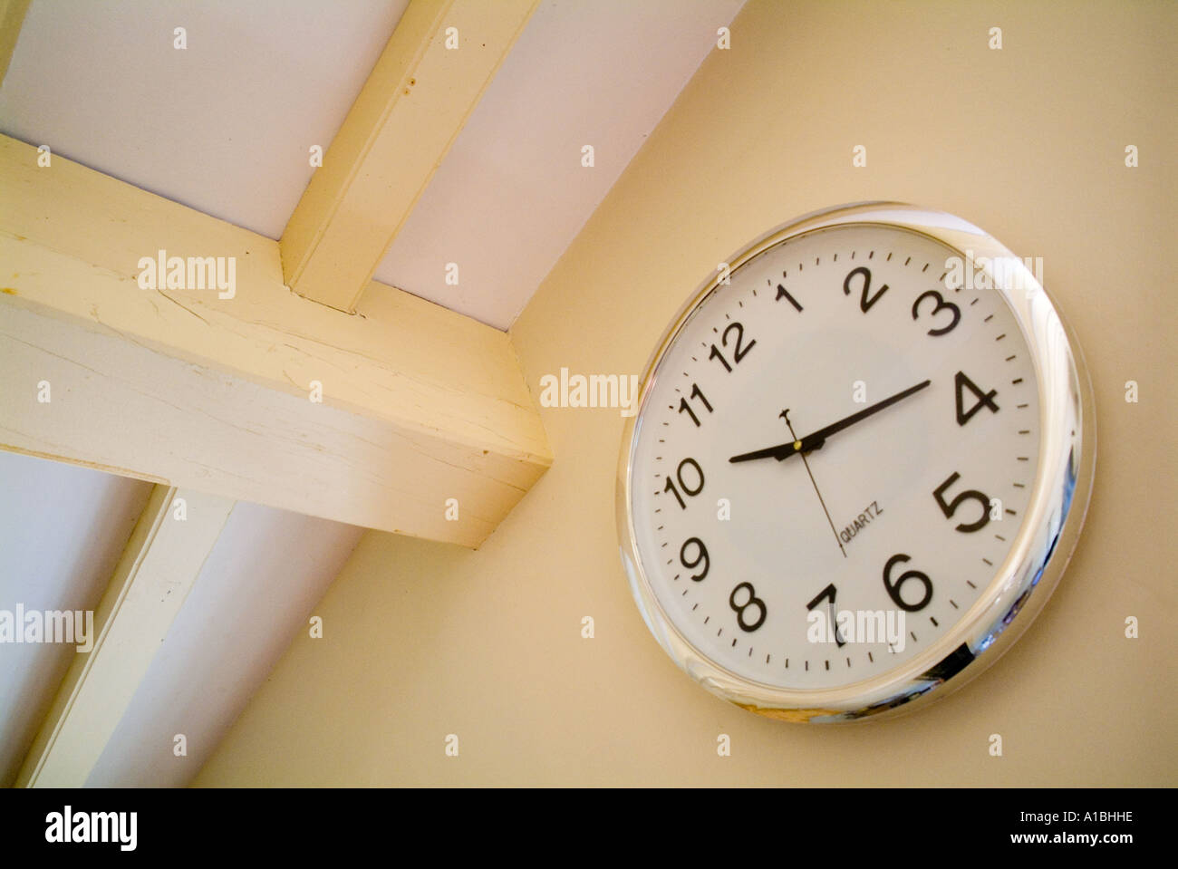 Clock on a kitchen wall - Stock Image