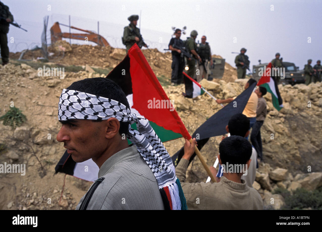 Palestinian protesting fence contsruction, Abu Dis. - Stock Image