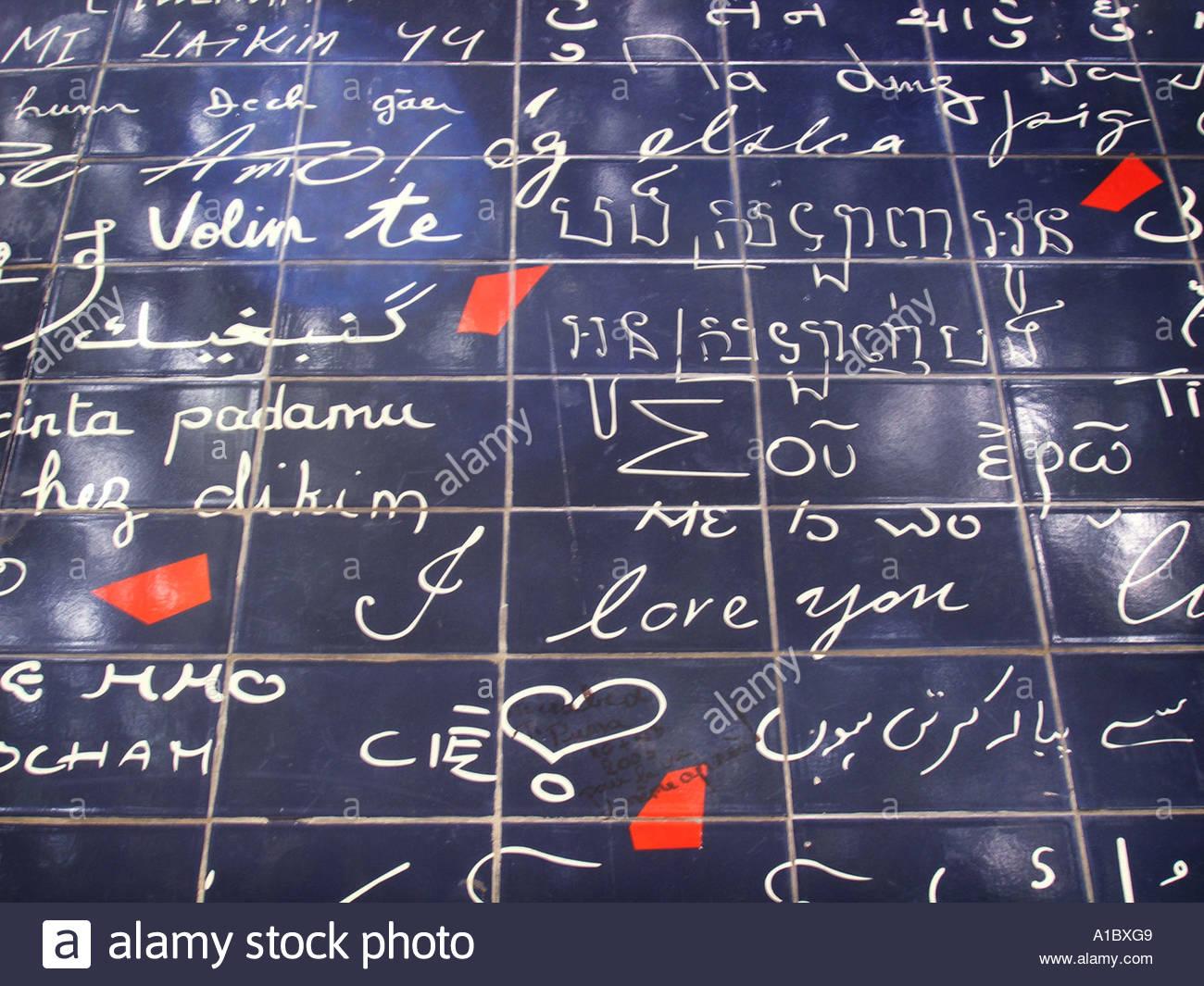 detail of Le Mur Bleu, love wall near Place des Abbesses Paris France - Stock Image